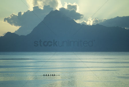 Moody : Mountain silhouette upon river sunrise
