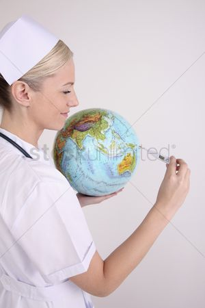 Thermometer : Nurse checking thermometer while holding globe