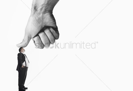 Office worker : Office worker being bushed by large thumb