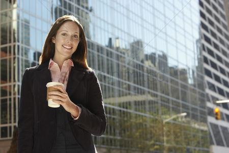 Jacket : Office worker with drink outside office building portrait