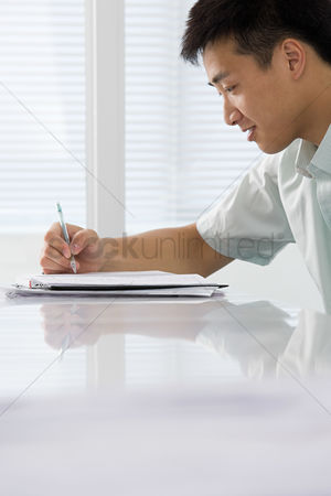 Interior : Office worker writing