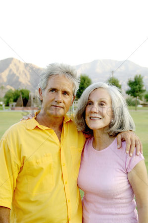 Affectionate : Old couple posing for the camera
