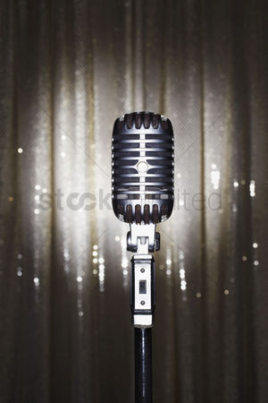 Retro : Old fashioned microphone in front of stage curtain