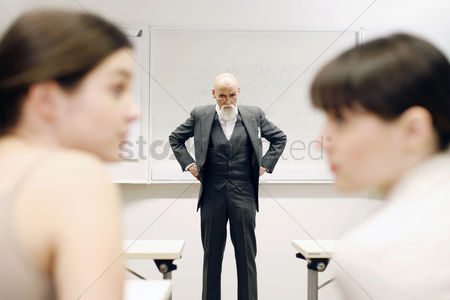 Bald : Old professor scolding his students for talking in the class