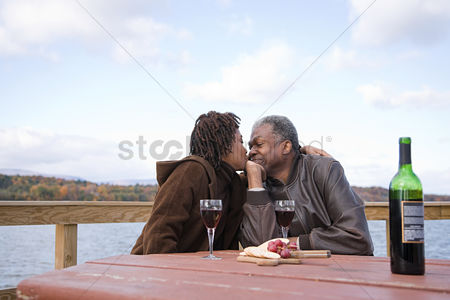 Grapes : One woman kissing a man