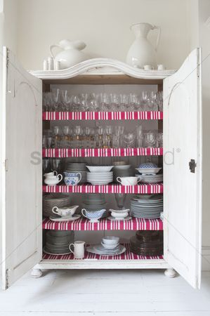 England : Open storage cupboard showing display of homeware