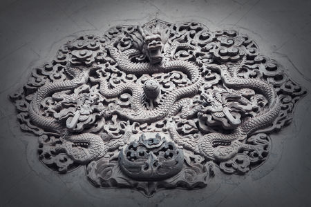 Sculpture : Ornate low relief sculpture of dragon on wall