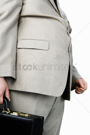 Pocket : Overweight man carrying briefcase mid section side view