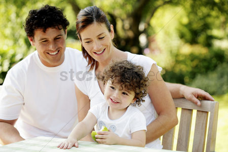 Smiling : Parents and daughter in the park