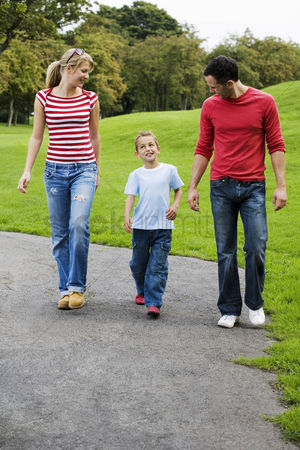 Denim : Parents and son walking in the park