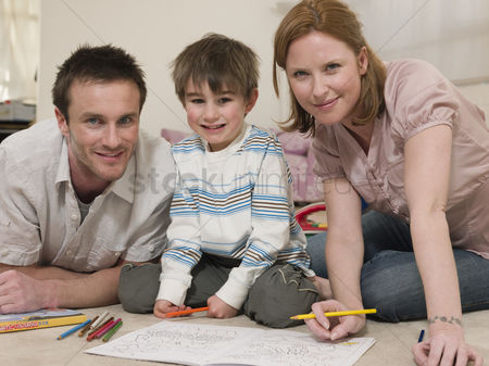 Offspring : Parents on floor coloring with son