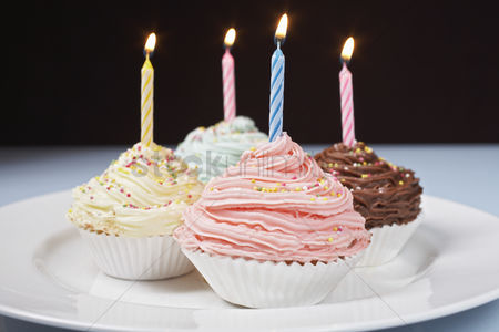 Ready to eat : Pastel cupcakes with birthday candles on plate