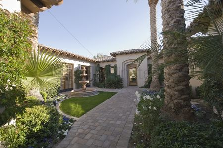 Grass : Paved path and water fountain in palm springs garden exterior
