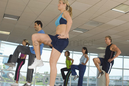 Fitness : People exercising in step aerobics class
