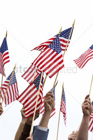 Demonstration : People holding up american flags high section