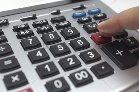 Pushing : Person using calculator close-up of finger