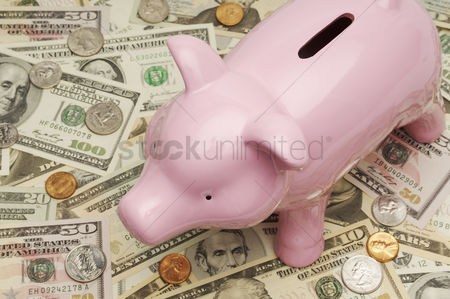 High angle view : Piggy bank on money