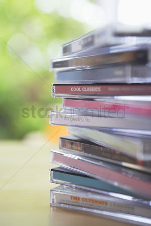 Collection : Pile of cd jewel cases on table close-up