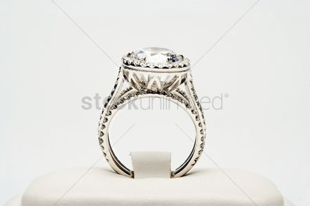 Symbol : Platinum ring with 5 carat centre diamond surrounded by full cut 0 80 carat diamonds