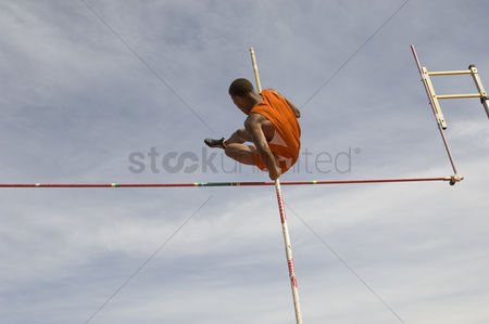 Pushing : Pole vaulted in mid-air low angle view
