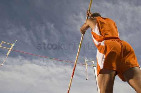 Pushing : Pole-vaulter preparing for jump
