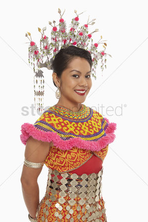 Bidayuh ethnicity : Portrait of a cheerful woman in an iban traditional clothing