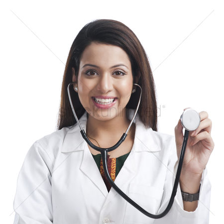 Housewife : Portrait of a female doctor showing a stethoscope