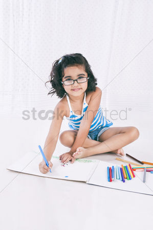 Bliss : Portrait of a girl making a drawing and smiling