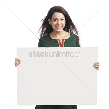 Housewife : Portrait of a happy woman holding a whiteboard