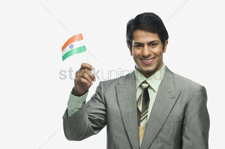 Respect : Portrait of a man holding indian flag
