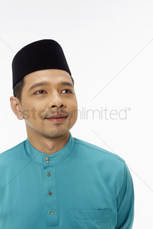 Baju melayu : Portrait of a man in traditional clothing smiling
