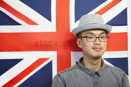 British ethnicity : Portrait of a mid adult man against british flag