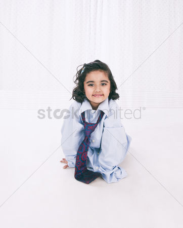 Satisfying : Portrait of a smiling girl wearing oversize shirt with tie