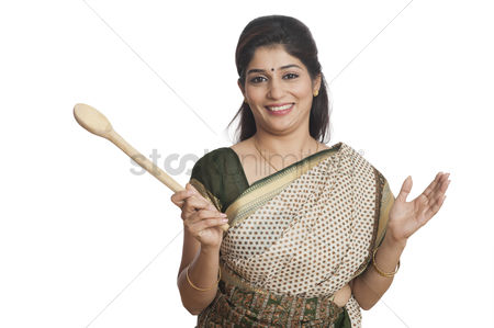 Housewife : Portrait of a woman holding wooden ladle