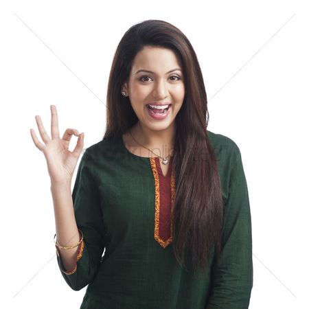 Housewife : Portrait of a woman showing ok sign and smiling
