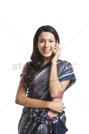 Housewife : Portrait of a woman talking on a mobile phone and smiling