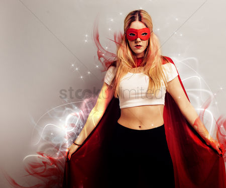 Background : Portrait of a young woman dressed as superhero