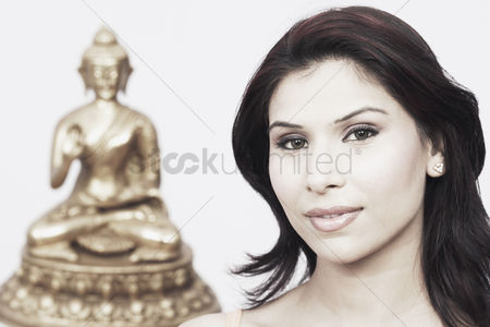 Sculpture : Portrait of a young woman with a statue of buddha behind her