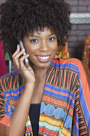 Traditional clothing : Portrait of an african american female fashion designer on phone call