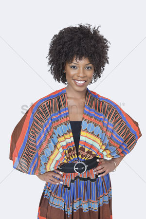 Traditional clothing : Portrait of beautiful african american woman in traditional wear standing over gray background
