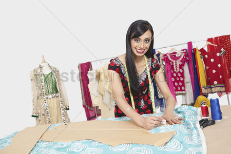 Traditional clothing : Portrait of beautiful indian female fashion designer working