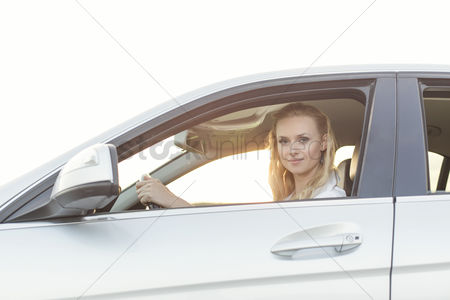 Land : Portrait of beautiful woman driving car