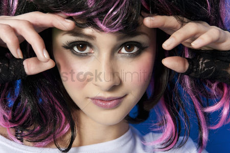 Head shot : Portrait of beautiful young woman wearing wig