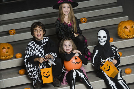 Steps : Portrait of boys and girls  7-9  wearing halloween costumes on steps