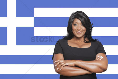 Respect : Portrait of casual mixed race woman against greek flag