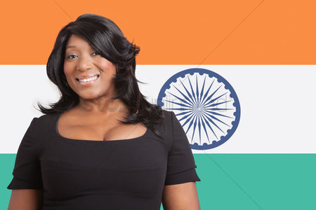 Respect : Portrait of casual mixed race woman over indian flag