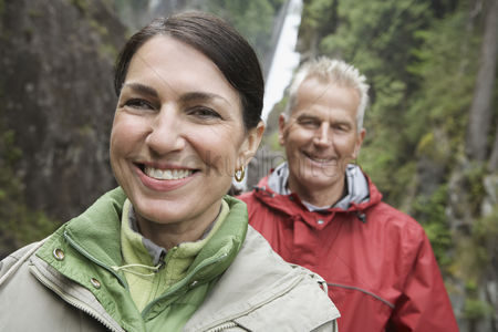 British ethnicity : Portrait of man and woman smiling waterfall in background