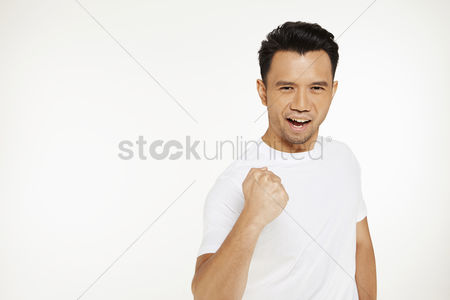 Excited : Portrait of man cheering