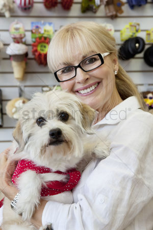 Large group of animals : Portrait of senior pet owner shop with dog