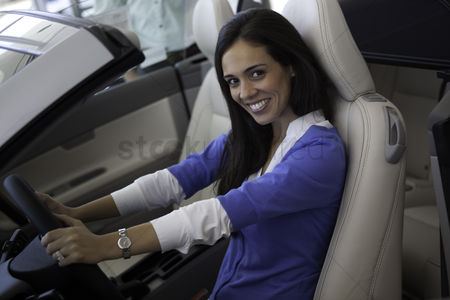 Land : Portrait of smiling woman sitting in front seat of car